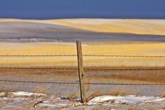 Snow hills Saskatchewan. Winter in Saskatchewan Canada fence post Stock Photography