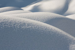 Snow hills in sunny weather Stock Images