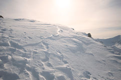 Snow hills on sunset Stock Photography