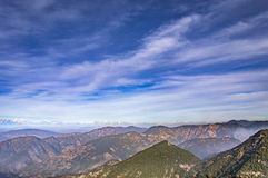 Snow on himalayan peaks and blue sky Stock Photography