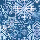Snow holiday background. Snowflakes texture. Blue christmas pattern Royalty Free Stock Photos