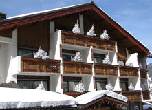 Snow on hotel with white Christmas trees Royalty Free Stock Photos
