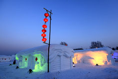 Snow house and red lantern Stock Photos
