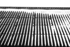 Snow on the house roof in black and white. Abstract background and texture for design Stock Photo