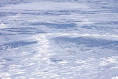 Snow hummocks on frozen reservoir Royalty Free Stock Photos