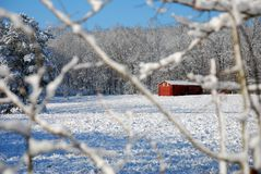 Snow and ice in country pasture with red barn, Georgia royalty free stock image