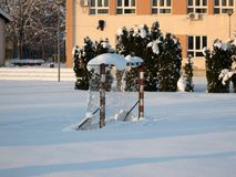 Snow and ice covered football court in the winter freezing day. River Danube environment, Futog Serbia.  royalty free stock photo