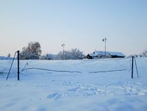 Snow and ice covered volleyball court in the winter freezing day. River Danube environment, Futog Serbia. Snow and ice covered volleyball court in the winter royalty free stock photos