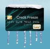 Snow and ice on a credit card illustrate the theme of putting a freeze on your credit report. Illustration royalty free stock images