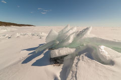 Snow, ice, hummocks on snow-covered ice of lake. A natural winte Stock Photography
