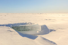 Snow, ice, hummocks on snow-covered ice of lake. Royalty Free Stock Image