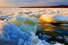 Snow and ice melt in Heilongjiang. The spring snow melt many ice cubes floating in Heilongjiang Stock Photos