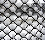 Snow and ice on a metal grid Stock Photography