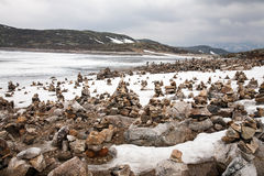 Snow, ice and rock piles are arranged Royalty Free Stock Photos
