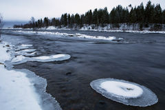 Snow and ice on the rocks in the river. Stock Photos