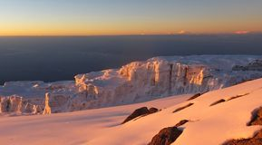 Sunrise on the glaciers at the top of the Kilimanjaro. Snow ice and summit in Tanzania Stock Photos