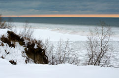 Snow and ice at sun set on the great lakes Stock Images
