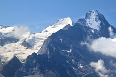 Snow and ice upon the Swiss Jungfrau and Eiger royalty free stock image