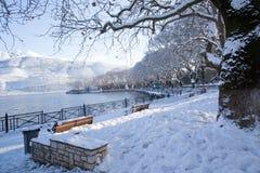 Snow ice winter season trees road in Ioannina city Greece. Snow ice forst winter season trees road in Ioannina city Greece royalty free stock photo