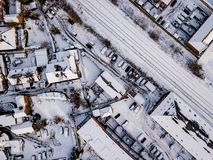 Aerial view of snow compromised rail and road networks. Royalty Free Stock Photos