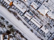 Aerial view of snow compromised rail and road networks. Royalty Free Stock Image