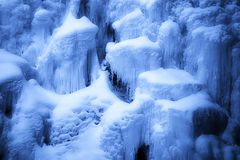 Snow And Icicles On Rocks Royalty Free Stock Photography