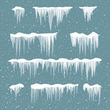 Snow icicles set. Icicles on blue background. Snowfall in motion. The ice under the snow caps. Vector set of icicle