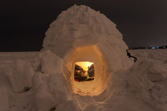 Snow igloo on the frozen sea on a background of the night Stock Photos