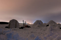 Snow igloo on the frozen sea on a background of the Northern Lights. Snow igloo on the frozen sea at night stock photos
