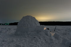 Snow igloo on the frozen sea at night Royalty Free Stock Images