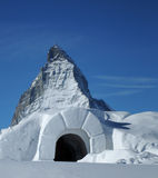 Snow igloo at Matterhorn. A view of the entrance to a snow igloo with the famous Matterhorn mountain peak in the background Stock Images