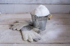 Snow In A Bucket With Gloves, Covered With Snow. Royalty Free Stock Image