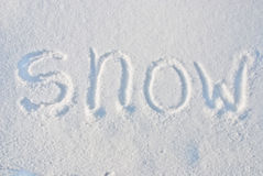 Snow. The inscription on the first fluffy snow Stock Images