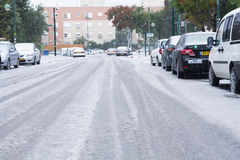 Snow in Israel. 2013. RAMLA , ISRAEL - DECEMBER 13 , 2013 : Israeli street covered with snow Stock Photography
