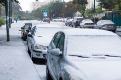 Snow in Israel. 2013. RAMLA , ISRAEL - DECEMBER 13 , 2013 : Israeli street covered with snow Royalty Free Stock Images