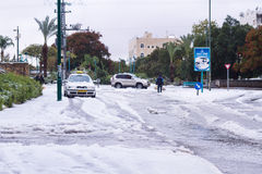 Snow in Israel. 2013. RAMLA , ISRAEL - DECEMBER 13 , 2013 : Israeli street covered with snow Royalty Free Stock Photo