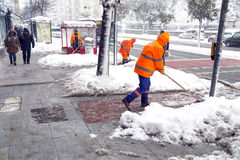 Snow in Istanbul, municipality workers Royalty Free Stock Photos
