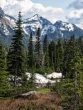 Snow on Jagged mountain peaks Stock Photos