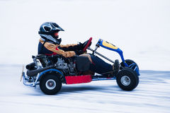 Snow Karting. Motion blurred image of go kart race in winter royalty free stock images