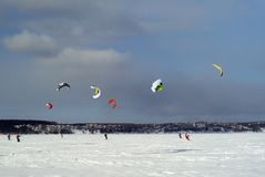 Snow kiter on the ice of a frozen lake royalty free stock photo