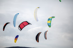 Snow kiting on a snowboard on a frozen lake Royalty Free Stock Photography