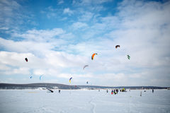 Snow kiting on a snowboard on a frozen lake Royalty Free Stock Image