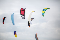 Snow kiting on a snowboard on a frozen lake Royalty Free Stock Photos