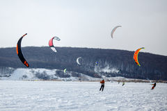 Snow kiting on a snowboard on a frozen lake Royalty Free Stock Images