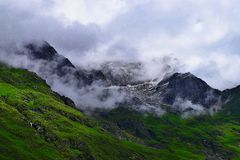 Snow-laden Peaks of Himalayan Mountains at Valley of Flowers National Park, Uttarakhand, India. Valley of Flowers National Park, Uttarakhand, India is surrounded Stock Photos