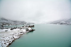 Snow lake with fog Royalty Free Stock Photos