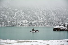 Snow lake with fog Royalty Free Stock Image