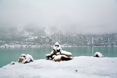 Snow lake with mani stone Royalty Free Stock Photography
