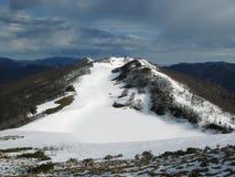 Snow lake in mountains. Snow mountains stock photography