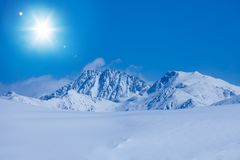 Snow land and rocky mountains Royalty Free Stock Photography